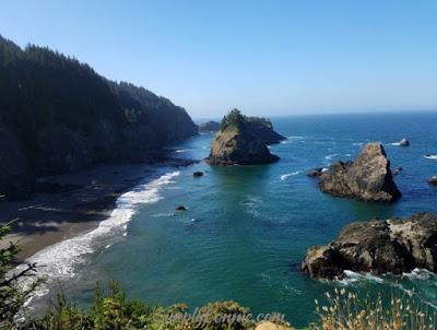 arch rock overlooking pacific ocean