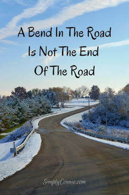 A bend in the road is not the end of the road.